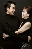 Couple with arms around each other - Asia Images Group
