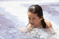 Girl swimming in pool, head above water - Asia Images Group