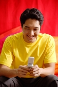 Man using mobile phone, smiling - Asia Images Group