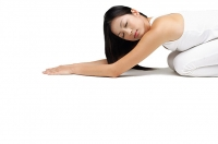 Woman kneeling on floor - Asia Images Group