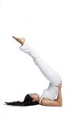 Woman doing yoga, shoulder stand position - Asia Images Group