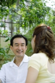 Husband looking at wife, smiling - Asia Images Group
