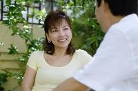 Woman facing man, smiling - Asia Images Group