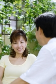 Mature couple sitting together, wife looking at camera - Asia Images Group