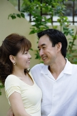 Couple looking at each other, smiling - Asia Images Group