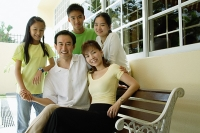 Family with three children, smiling at camera - Asia Images Group