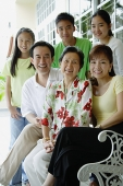 Three generation family smiling at camera - Asia Images Group