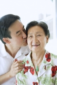 Son kissing mother on cheek - Asia Images Group
