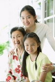 Grandmother sitting with her granddaughters - Asia Images Group