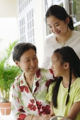Grandmother with two granddaughters - Asia Images Group