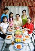 Three generation family around dining table, portrait - Asia Images Group