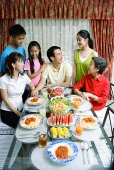 Three generation family at dining table - Asia Images Group