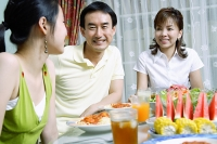 Family with teenage daughter at dining table - Asia Images Group