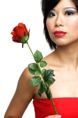 Woman with single stalk of rose - Asia Images Group