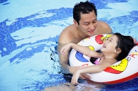 Father and daughter in swimming pool - Asia Images Group