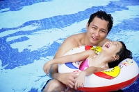 Father with one daughter in swimming pool - Asia Images Group
