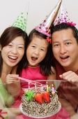 Family with one daughter celebrating a birthday - Asia Images Group