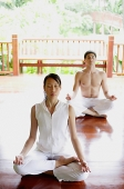 Two people in yoga position - Asia Images Group