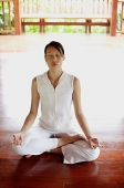 Woman sitting in lotus position - Asia Images Group