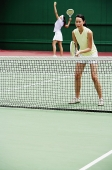 Women playing tennis - Asia Images Group