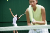 Women playing tennis together - Asia Images Group