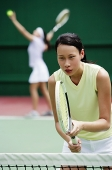 Woman holding tennis racket - Asia Images Group