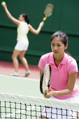 Two women playing tennis, mixed doubles - Asia Images Group