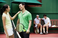Couples at tennis court - Asia Images Group
