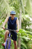Man riding bicycle - Asia Images Group