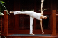 Woman doing yoga - Asia Images Group