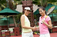 Two women shaking hands, tennis match - Asia Images Group