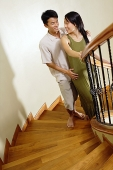 Couple on staircase - Asia Images Group