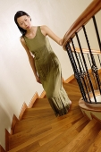 Woman on staircase, looking at camera - Asia Images Group