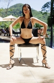 Woman in bikini, wearing high heels, legs apart - Asia Images Group