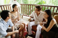 Young adults sitting together, having coffee - Asia Images Group