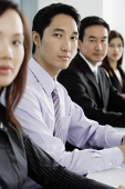 Business people sitting in a row - Asia Images Group
