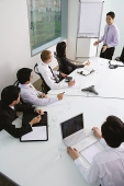 Executives in a meeting - Asia Images Group