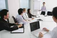 Executives in a presentation meeting - Asia Images Group