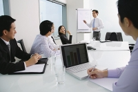 Executives having a meeting in conference room - Asia Images Group