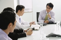 Businessmen in a meeting - Asia Images Group