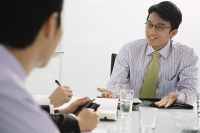 Businessmen having a discussion - Asia Images Group