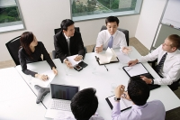 Executives at a meeting - Asia Images Group