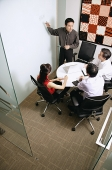 Executives in room, having a meeting - Asia Images Group