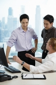Male executives in office, having a discussion - Asia Images Group