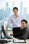 Male executives in office, smiling at camera - Asia Images Group