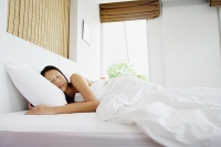 Woman in bedroom, sleeping - Asia Images Group