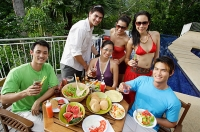 Young adults on patio, smiling at camera - Asia Images Group