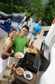 Couples at barbeque party - Asia Images Group