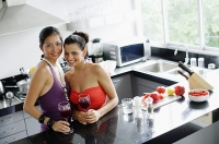 Two women in kitchen - Asia Images Group