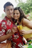 Couple side by side, holding drinks, looking at camera - Asia Images Group